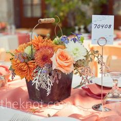 orange and white mix in copper buckets ~ casual outdoor wedding