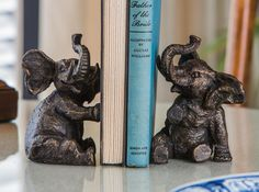 Cast of iron with bronze finish, these Elephant Bookends are sufficient to hold up even the most stubborn leaning books. $75