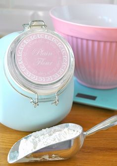 Um...I'm going to need a larger flour bin than that!...but it's still a cute canister :-)