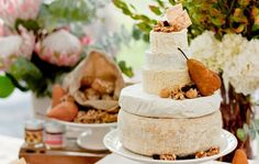 Wedding appetizer cheese-cake decorated with nuts and fruit. Cut during appetizer hour