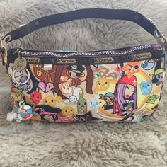 ⚓️Tokidoki Pirata Pirate pattern bag by LeSportsac Amazing condition - Nylon fabric with no flaws!! Has the cute bear figurine keychain attached, rainbow zipper and LeSportsac branded carabiner inside. Sorry no trades. tokidoki Bags Mini Bags