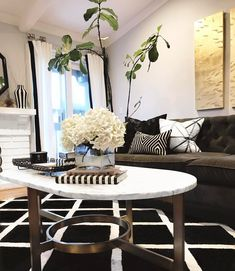 """Trying this new thing called """"maybe if I always have fresh flowers on the coffee table no one will notice my naked halfway dead tree in the back""""  how am I doing?! #champagnelifestylehome"""