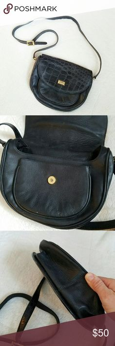 """Vintage Ferre Handbag Excellent condition vintage handbag made by Ferre, which is Italian made. Black leather with crocodile pattern to the leather. Gold hardware and adjustable shoulder strap. Bag measures 10.5"""" across and 8.5"""" in height. Strap measures 47"""" at its longest. Ferre Bags"""