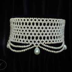 Dramatically wide white woven seed pearl choker with graduated pearl drapes and large pearl drop beads. Inspired by Le Belle Époque Fashions.