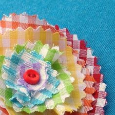 Rainbow gingham flower clip