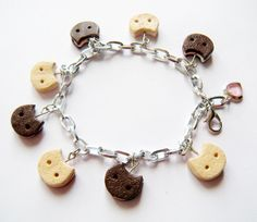 Steven Universe: Cookie Cat charm bracelet by SweetPandaFish on Etsy https://www.etsy.com/listing/224589217/steven-universe-cookie-cat-charm