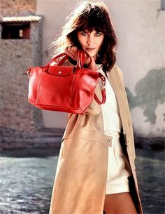British model-television host Alexa Chung is pictured on a sunny holiday with Longchamp bags in Saint-Tropez for the accessories label's Spring Summer 2014 campaign Alexa Chung, Catherine Mcneil, Daria Werbowy, Sasha Pivovarova, Tim Walker, Gisele Bundchen, Christy Turlington, Saint Tropez, Kate Moss