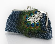 Peacock Feather Clutch in Navy with Rhinestone Brooch 8-inch PEACOCK PASSION. $80.00, via Etsy.