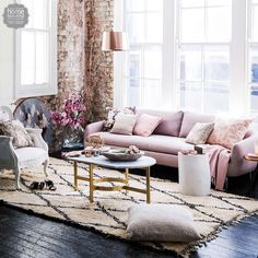 Love the blissfully creamy pink sofa with the brick & brass light. Chic & modern