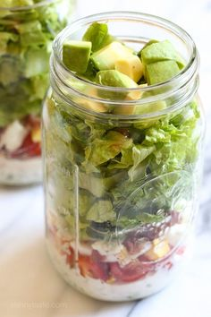 Chicken, tomatoes, bacon, avocado, eggs, blue cheese and lettuce all conveniently layered in a jar with a light homemade ranch – portable…
