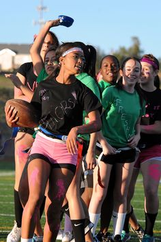 Seniors, pink, and freshmen, green, compete Oct. 2 during a powder puff football game at Vista Ridge High School in Falcon School District 49. The school's seniors defeated its freshmen, 24-12, during a jovial pre-homecoming football tournament. Boys and girls swapped sports for the school's annual powder puff and peach fuzz games. Football players from each class level coached a girls football team, and then volleyball players took charge of a boys volleyball team.