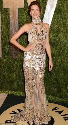 Exotic: Victoria's Secret Angel Alessandra Ambrosio made an entrance in a sheer gold embellished halterneck gown @ Vanity Fair Oscars Party