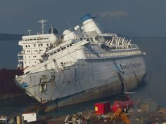 Images taken by Selim San yesterday show that cutting and demolition has begun on the ACIF, the ex SEA VENTURE, PACIFIC PRINCESS, PACIFIC at Aliaga.  The radio mast is gone; the forward portion of the superstructure has begun to vanish on the starboard side and preliminary cuts have been made in the still listing ship's bow.