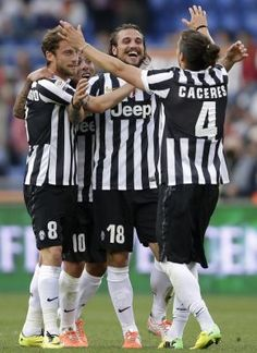 Juventus\' Osvaldo celebrates with his teammates Marchisio, Tevez and Caceres after scoring against AS Roma during their Italian Serie A soccer match in Rome