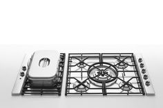 Alpes Inox - BUILT-IN HOBS WITH CAST IRON GRID - Gas hobs and electric grill with cast iron pan supports. Burners set well apart for large pans. DUAL triple crown burner at the centre