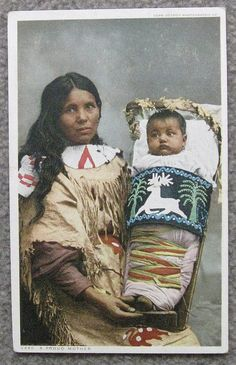 There's no date or postmark on this old postcard which shows a Native  American woman with her baby in a beautiful cradleboard