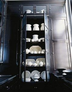 Black cabinet shows off white dish collection