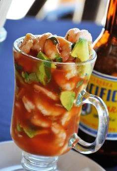 Mexican Shrimp Cocktail: 1-2 lb shelled and cooked shrimp (50-60 count), 2 large chopped tomatoes, ½ small white onion (chopped) or 2 green onions (chopped), ½ cup cilantro slightly chopped, ½ jalapeno (diced with seeds), 1 avocado (chopped), tomato juice (V8),Ketchup,  lime juice, salt and pepper. Mix all in glass bowl and chill