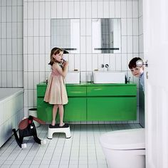 Children's bathroom - The green lacquered vanity unit adds a sense of fun in the minimal white space. The proportion of these tiles helps to stretch out the room ... http://www.bathroom-paint.net/bathroom-type.php