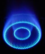 Everyday Chemistry - Why does a kitchen gas burner glow yellow when liquid comes in contact with it?