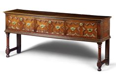A DRESSER,  CHARLES II, LATE 17TH CENTURY  oak, the three drawers with mitred mouldings and later handles, including ring turned front legs and lateral stretchers