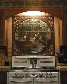 "Individual art tiles make up a mural or tile ""painting,"" this time behind a vintage stove. Courtesy RTK Studios."