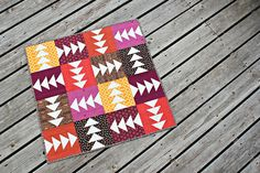 Nice take on multi-directional flying geese. Fun colors too! Block by Meghan Bohr of Canoe Ridge Creations.