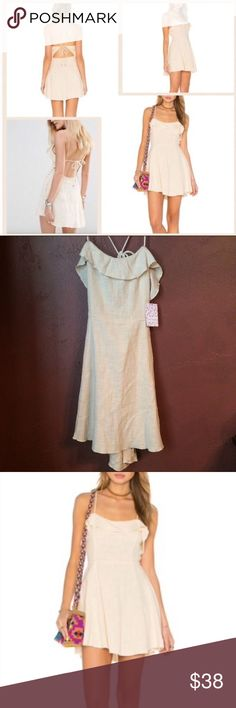 "Free People More than a mini cotton Beige dress L 🌺Free People🌺Reasonable offers welcomed! Free People Beige More than a Mini Dress, Size: Large Color: Beige Retail: $78.00 Condition: New with tags Silhouette: Fit & Flare Details:  - Square neck with ruffle trim - Sleeveless - Lace-up crisscross back with seashell ends, can be done in multiple ways see first photo  - Button loop back closure - Slips on over head - Approx. 32"" length - Imported Fiber Content - 100% cotton Care - Hand wash…"