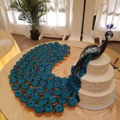 The 12 most impressive cupcake cakes on the net! And they are easy to .- Die 12 beeindruckendsten Cupcake-Kuchen im Netz! Und sie sind leicht zu … – Ar… The 12 most impressive cupcake cakes on the net! Peacock Cupcakes, Peacock Cake, Peacock Wedding Cake, Cupcake Wedding, Peacock Decor, Peacock Theme, Pastel Cupcakes, Wedding Cakes With Cupcakes, Fruit Wedding