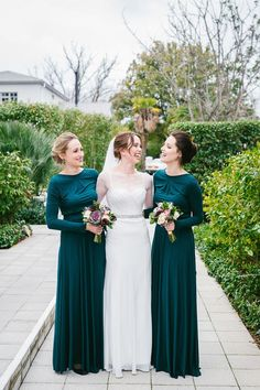 Winter green bridesmaid dresses | SouthBound Bride | http://www.southboundbride.com/elegant-winter-town-hall-wedding-by-dearheart-photos-pietro-adriaan | Credit: Dearheart Photos