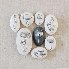 painted mushrooms on rocks