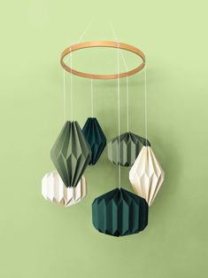 """A stunning hand crafted hanging mobile consisting of six individual geometric shapes folded from specialty stocks. A beautiful wooden """"halo"""" hovers above—complementing the materials below. A unique display worthy of any nursery or child's room. Child's Room, Nursery Room, Nursery Decor, Hanging Mobile, Green Cream, Kidsroom, Geometric Shapes, Baby Shop, Babyshower"""