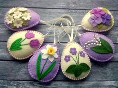 Felt easter decoration – purple felt eggs with spring flowers including lily of the valley flowers, violet flowers, tulips, daffodils and hydrangea flowers. Listing is for 6 ornaments: & Tiny Flowers, Felt Flowers, Spring Flowers, Easter Egg Crafts, Easter Eggs, Easter Decor, Lilac Background, Lily Of The Valley Flowers, Hydrangea Flower