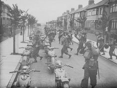 A 'fighting column' from the South Wales Borderers man their motorcycles which are parked in a suburban street in Bootle, Liverpool, England, 16 August 1940. This training operation formed part of British preparations to repel the threatened German invasion of 1940.