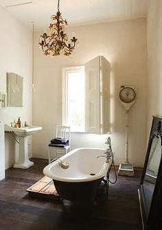 vintage bathroom....love the chandelier