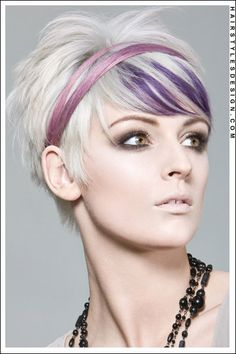white blonde with lavender streaks. try Manic Panic Electric Amethyst