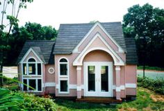 Contemporary Miniature Replica. This replica sits atop a hill overlooking a tennis court. A bay window and window seat allow the occupant to view the tennis matches. Other features include French doors and round interior columns.