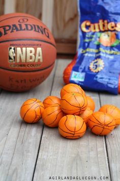 DIY - make these fun mini basketballs using clementines and a sharpie! Such a great idea for a March Madness party or a birthday party!