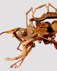 Indonesian artist Dedy Shofianto creates unusual kinetic sculptures of insect-like creatures by carving almost every component from wood. Though powered by hidden electronics it's the exquisitely detailed mandibles, wings, antennae, and gears of these hybrid creatures crafted from locally s