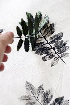 Make a pattern with pressed leaves.