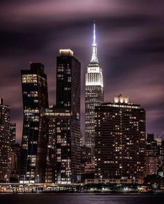 Manhattan at night by KSayegh  New York City Feelings  The Best Photos and Videos of New York City including the Statue of Liberty, Brooklyn Bridge, Central Park, Empire State Building, Chrysler Building and other popular New York places and attractions.
