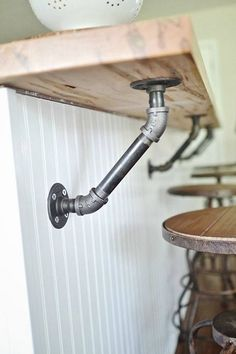 Use industrial pipes to hold up a wood bar! Garage, ideas, man cave, workshop, organization, organize, home, house, indoor, storage, woodwork, design, tool, mechanic, auto, shelving, car.