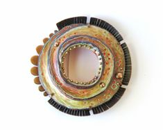 """Annie Pennington,  """"Diatom Series: Vacuole"""" brooch. 2013. Sterling silver, copper, polymer, colored pencil, acrylic paint. 3 x 3 x 3/4 in."""