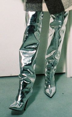 INSPIRATION | Nothing says sheer maximalism like Balenciaga's silver thigh-high boots. So '80s, so good. Especially with an oversized knit.