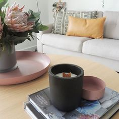 Mid week and we are slowly getting back into the swing of it......Still feels like we're on holidays  Leather Holders available via our website! #livingroom #boconcept #coffeetable #cushion #couch #interiormotivesaus #interiorstyling #homewares #leatherholder #candle #soycandle #leathercushion
