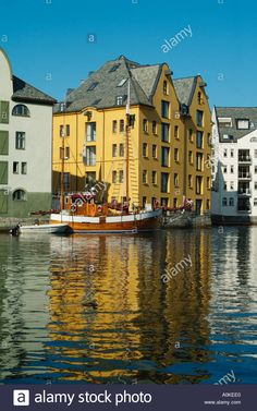 View of the waterfront Brosundet canal fishing boats and hotels Alesund More and Romsdal Norway Europe Stock Photo
