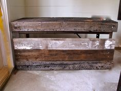 Reclaimed wood on industrial work bench...now acting as our studio's desk