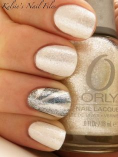 Shimmering vanilla and silver nails.