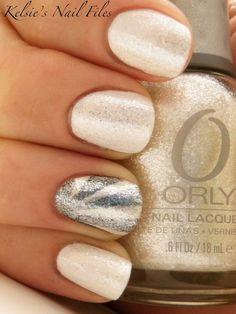 Shimmering vanilla and silver nails.