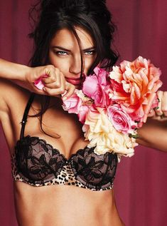 Adriana Lima in a Victorias Secret animal print balconette bra